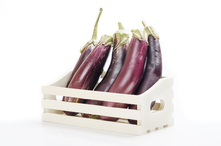 container box: long eggplants in a white box container