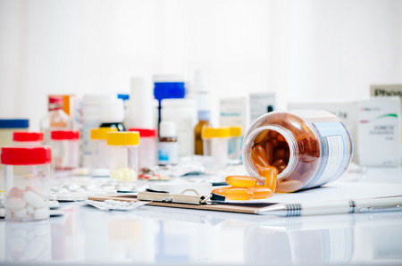 medicine background: medicine capsules laid out on a folder