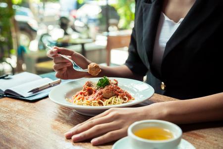 close up of woman eating spaghetti meatball Standard-Bild