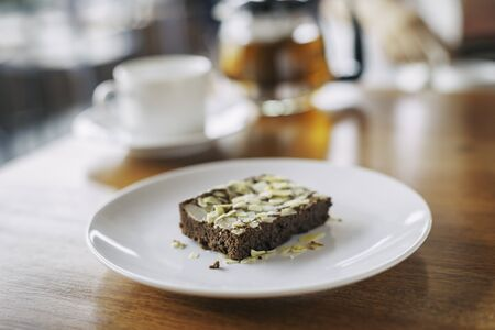 coffee and cake: close up of an almond brownie on plate Stock Photo
