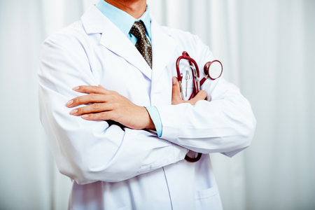 cross arms: doctor folding arms and holding a stethoscope