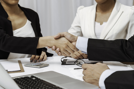 businessmen set an agreement with a handshake