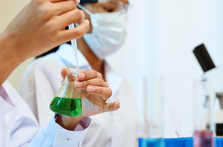 physicists: image of scientists experimenting and testing chemicals in laboratory