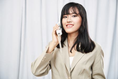individual: close up of businesswoman calling someone by telephone