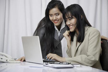 succeeding: close up of businesswomen succeeding in their work on computer Stock Photo