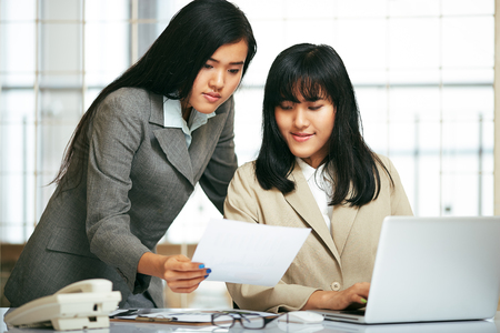 woman business suit: office staffs working and typing work in laptop