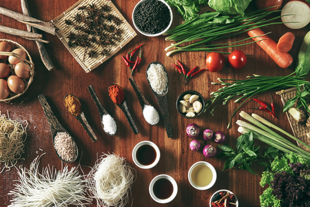 Large group of vegetables and ingredients on table Standard-Bild