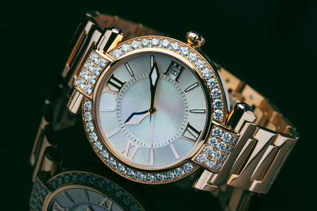 Elegant golden with diamond men's watch against dark background Banco de Imagens