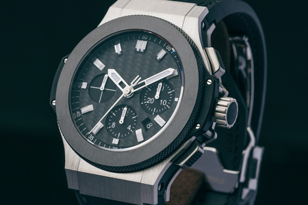 A luxury watch showing a time of 10:10