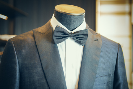 Closeup of black luxury tuxedo with bow tie