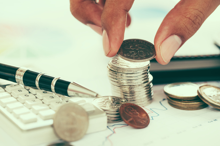 Concept of financial investment with hand holding coin Standard-Bild