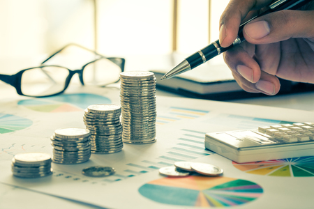 Financial analysis concept with coins, graph and eyewear Standard-Bild
