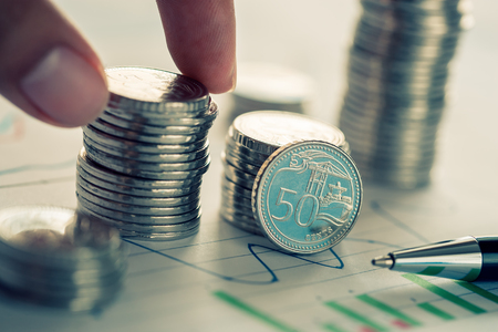 Concept of financial investment with coins and business chart