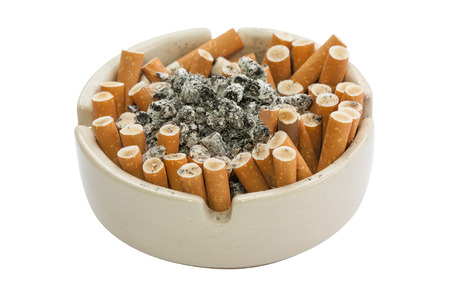 ashtray full of cigarette with isolated white background photo