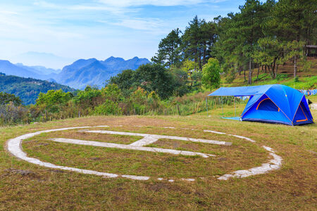 helicopter pad: Helicopter landing pad on mountain with tent in Doi angkhang, Thailand