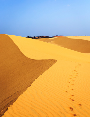 ne: Footsteps in desert White sand dune Mui Ne Vietnam