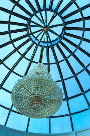 gass: Crystal chandelier on glass ceiling Stock Photo