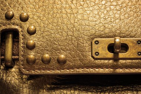 gold color: Closeup lock on woman leather bag, gold color