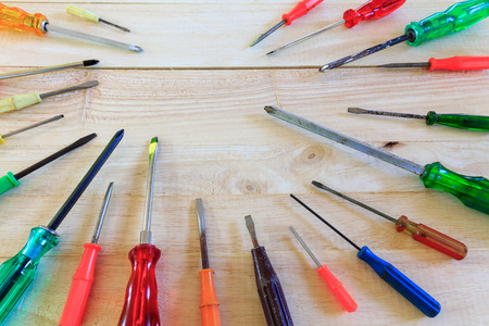 screwdrivers: Many screwdrivers on wooden background Stock Photo