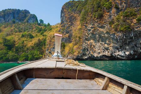 bow of boat: Bow of Thai long tail boat in a sea with island background, Krabi, Thailand Stock Photo