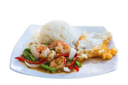 rice plate: Rice topped with stir-fried shrimps and basil Thai style  Kra prao gai  on isolated white background