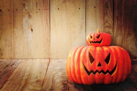jack o' lantern: Halloween pumpkin on wooden background