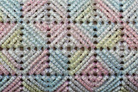 punto cruz: Textura de punto de cruz de colores en bolsa de mujer
