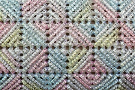 Texture of colorful cross stitch in woman bag
