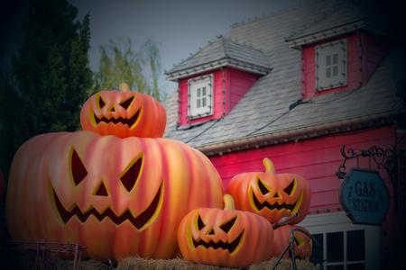 Halloween pumpkin in front of vintage house Stock Photo