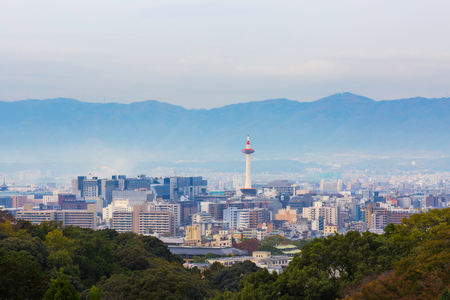 Kyoto city and tower with autumn trees in Japan