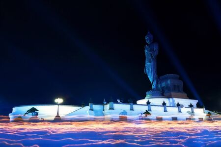rite: Light waving of candle rite walk on Visakha Puja Day at Watmaheyong in Phutthamonthon park, Nakhon Pathom, Thailand