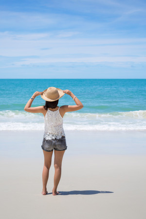samet: Back view of Travel asia woman with hat looking out of sea on a beach in summer, Koh Samet, Thailand
