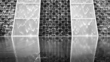 beauty fountain: Reflection of waterfall on tile wall