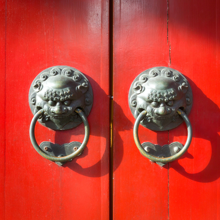 door knob: Old chinese door background with knob