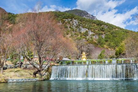 jade: Waterfall in Jade Water Village, Naxi minority village near the Jade Dragon Snow Mountain, Lijiang, Yunnan, China