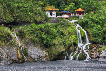 Changchun temple, Eternal Spring Shrine and waterfall at Taroko National Park in Hualien, Taiwan Фото со стока