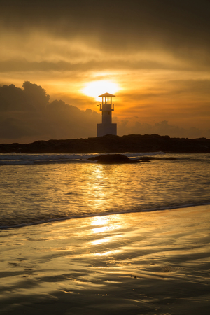 Seascape of Khao Lak with Lighthouse on beach in sunset at Phang Nga, Thailand Stock Photo