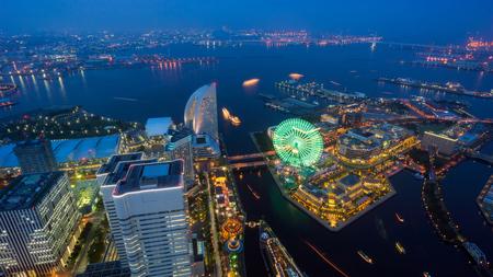 cosmo: Aerial night view of Yokohama city skyline and ferris wheel of Cosmo world at dusk in Yokohama bay, Kanagawa Prefecture, Kanto region, Japan