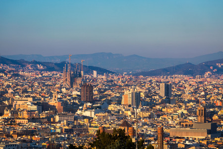 sagrada: BARCELONA, SPAIN - 31 DEC 2016: Barcelona city skyline with Sagrada familia at sunset in Catalonia, Spain Editorial