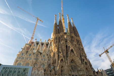 BARCELONA SPAIN - JANUARY 01 2017: La Sagrada Familia in day time, Large Roman Catholic cathedral in Barcelona, Spain, designed by Antonio Gaudi. Stock Photo