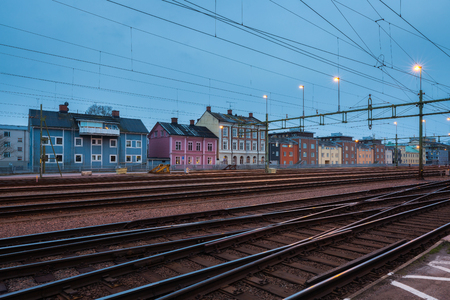 karlstad: Houses behind railway station at dusk in Karlstad, sweden