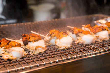 Grill scallop skewer is popular japanese street food at Tsukiji Fish Market Stock Photo