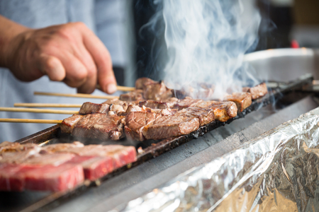 Japanese barbecue grill on skewers, street food in Japan