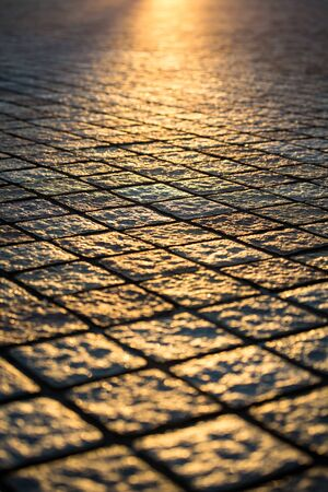Texture of cobble stone path with sunset light, Blur focus background grunge style
