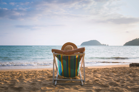 Summer beach vacation concept, Asia woman with hat relaxing on chair beach at Koh Mak, Trad, Thailand Imagens