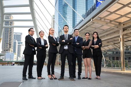 Group of professional business team walking outdoor with office building background 写真素材