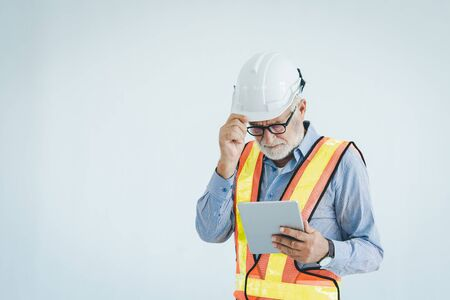 Engineer using tablet with safty helmet on white background, vintage style