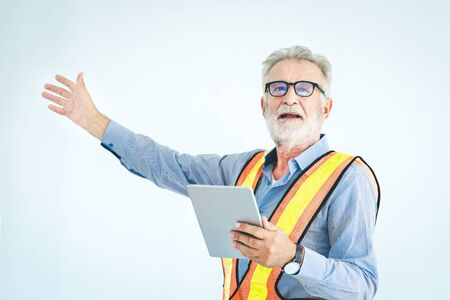 Engineer using laptop with safty helmet on white background, vintage style Imagens