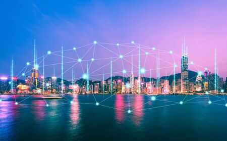 Network and Connection technology concept with Hong Kong city and light of boat background at dusk in Victoria harbor Imagens