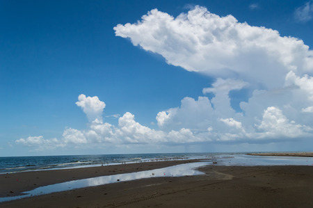 Cloudscape over the ocean and the beach